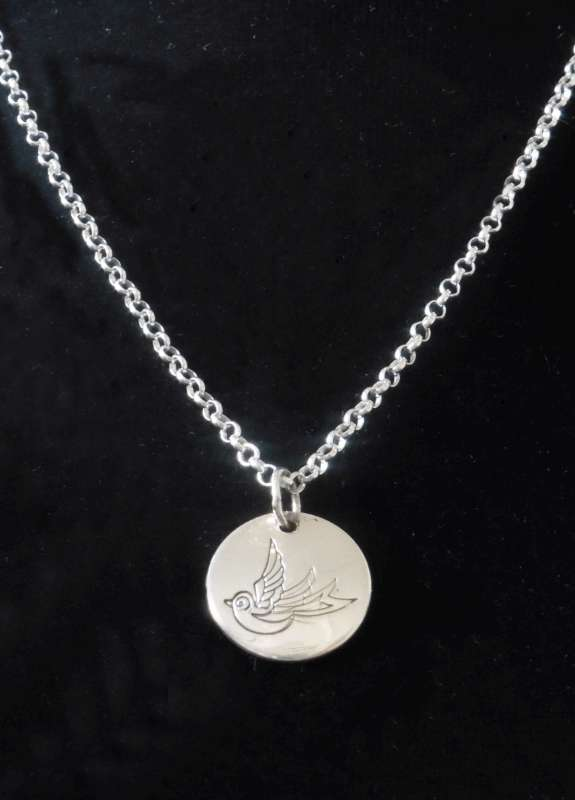 Swallow imprinted pendant