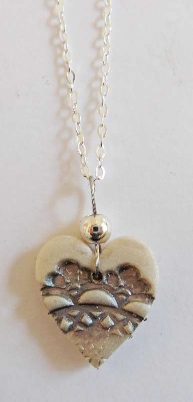 Medium ivory lace heart necklace