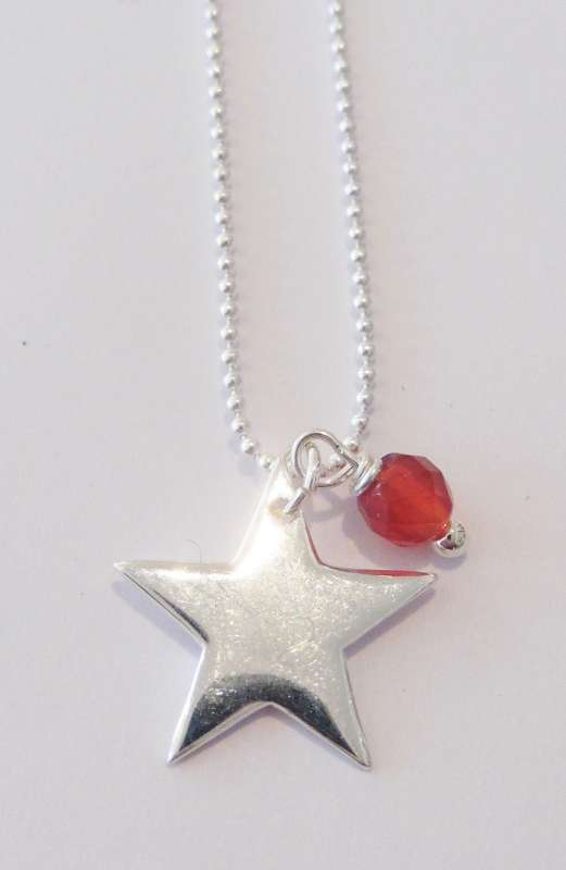 Silver necklace with start charm and carnelian