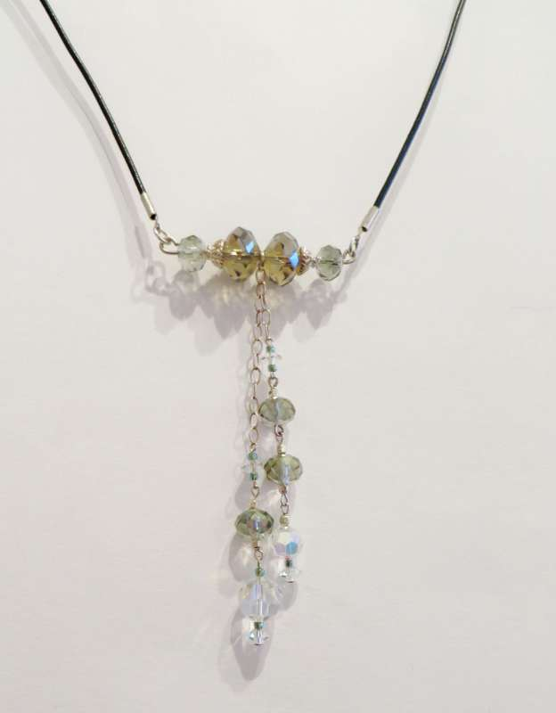 Swarovski and Chinese crystals, silver and leather pendant