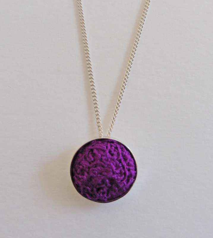 Purple stitched gem pendant with 16-inch chain