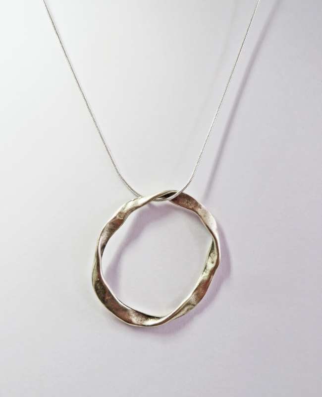 Single circle pendant on silver snake chain
