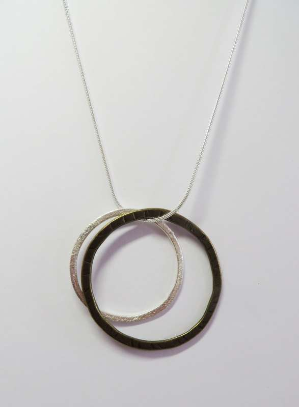 Double circle pendant on silver snake chain