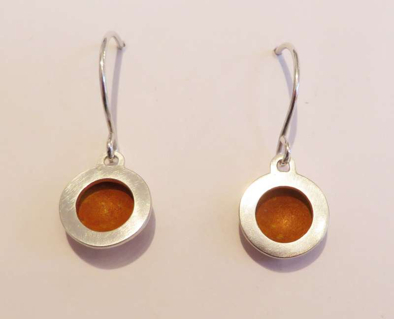 Silver and orange circle drop earrings