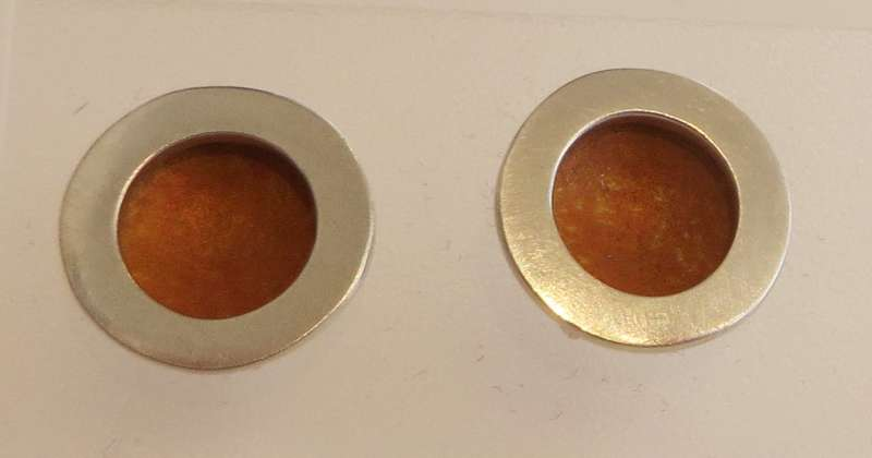Silver and orange circle stud earrings